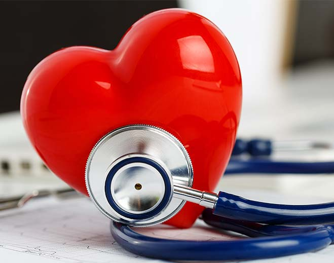 stethoscope touching a fake heart