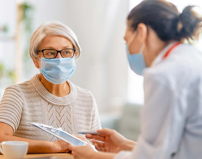 elderly lady talking to doctor